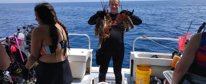 diversity diveboat guest with a lot of lobster